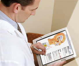 Picture of doctor filling out forms on tablet.